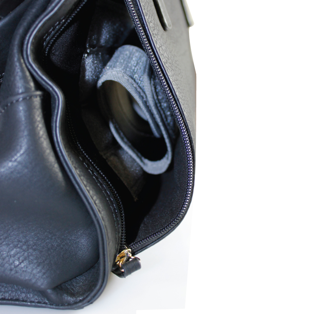 e663385b992 ... This concealed carry purse features ambidextrous access with discrete  zipper compartments located on both sides of ...